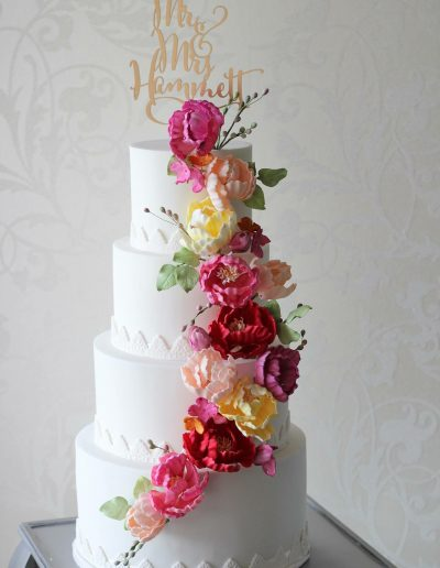 White Floral Cascade Wedding Cake